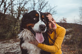 istock Young woman with dog 1060529342