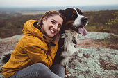 istock Young woman with dog 1060529534