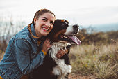 istock Young woman with dog 1062514132