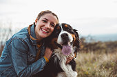 istock Young woman with dog 1062517762