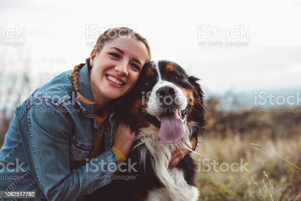 Young woman with dog picture id1062517762?b=1&k=6&m=1062517762&s=612x612&h=i4rjsow8sptn7lha2gjcjs7eaa4gijmlky5oxobekk4=