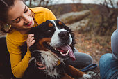 istock Young woman with dog 1062520742