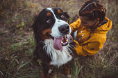 istock Young woman with dog 1062535940