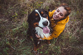 istock Young woman with dog 1062545842