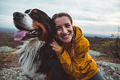 istock Young woman with dog 1062549192