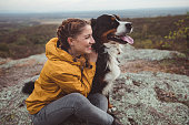 istock Young woman with dog 1178779959