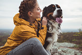 istock Young woman with dog 1178780095