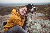 istock Young woman with dog 1178780196