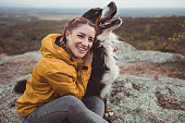 istock Young woman with dog 1178780276