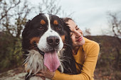 istock Young woman with dog 1178787776