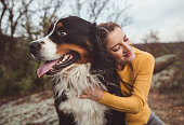 istock Young woman with dog 1178787857