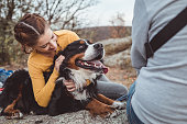 istock Young woman with dog 1178788294