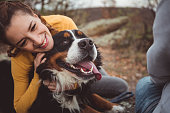 istock Young woman with dog 1178788345