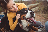 istock Young woman with dog 1178788379