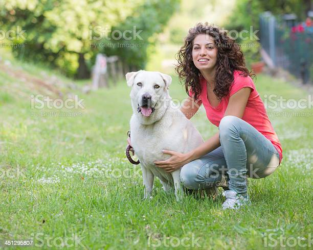 Young woman with dog picture id451295807?b=1&k=6&m=451295807&s=612x612&h=lx0ptqyrvza8cs8kskojemah0heej ul12 z48yqxao=