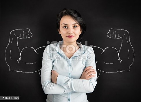 istock Young woman with drawn powerful arms 516069168