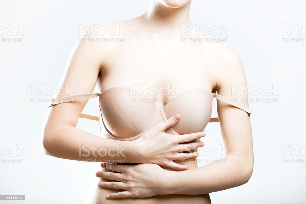 Young woman with droping bra strap, temptation stock photo