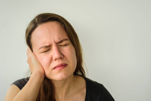 Young woman with ear pain