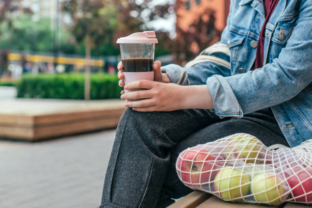 young woman with eco-friendly reusable coffee cup and cotton bag, zero waste concept - living a sustainable lifestyle stock pictures, royalty-free photos & images