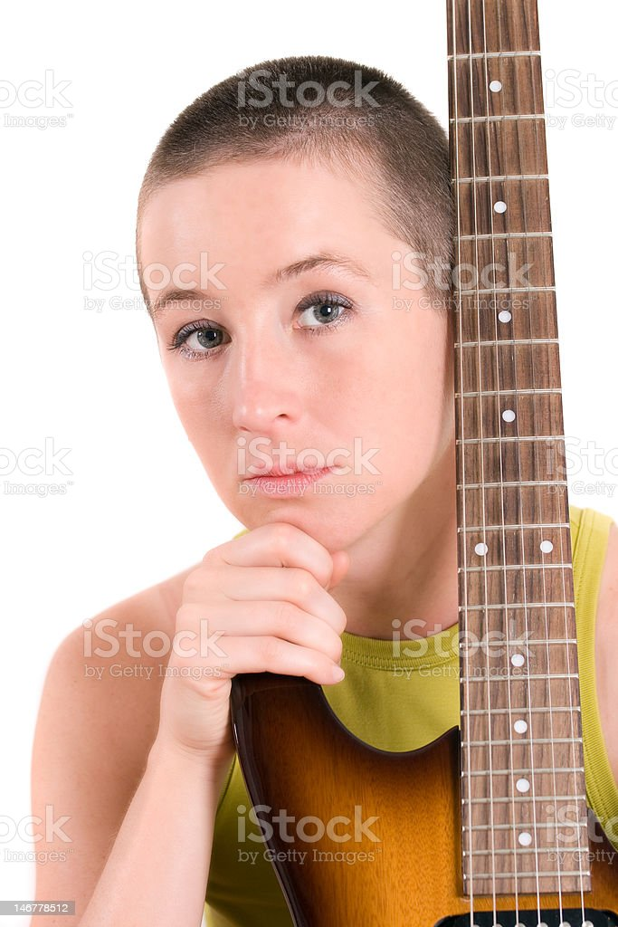 Young woman with electric guitar stock photo