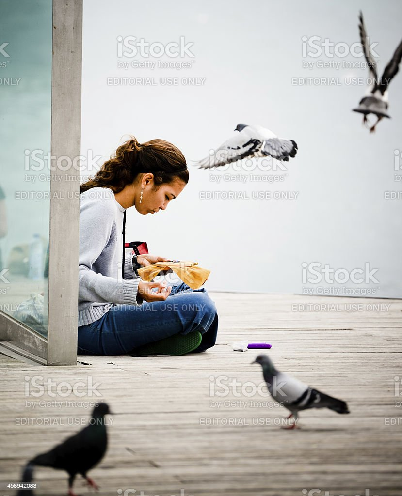 Young woman with embroidery sitting outdoors in Barcelona, Spain royalty-free stock photo