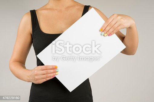 896826068 istock photo Young woman with empty sheet of paper 476229150