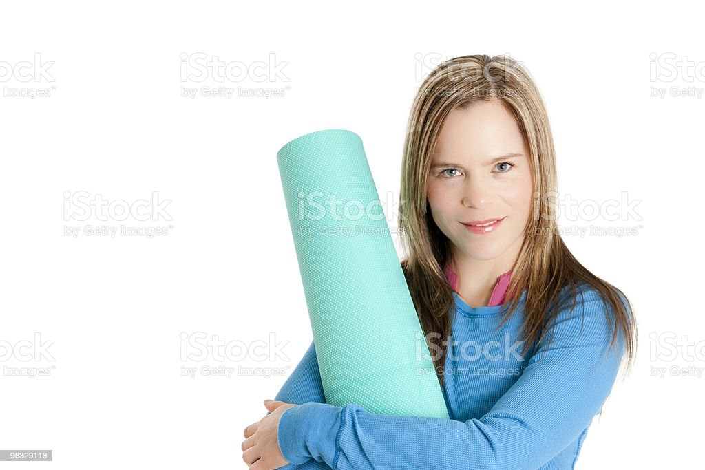 Young woman with execise mat royalty-free stock photo