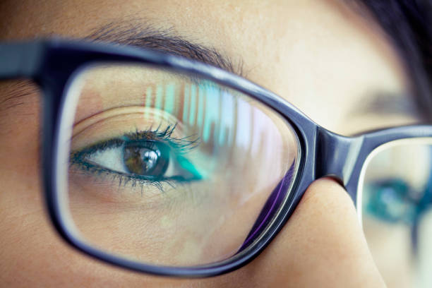 Young woman with eyeglasses, close-up of eye Young woman with eyeglasses, close-up of eye the bigger picture stock pictures, royalty-free photos & images