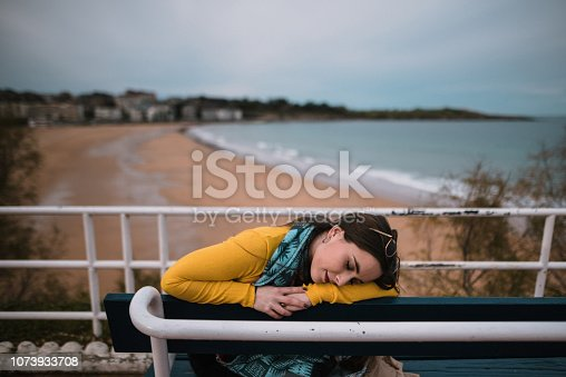 628497270 istock photo Young woman with eyes closed 1073933708