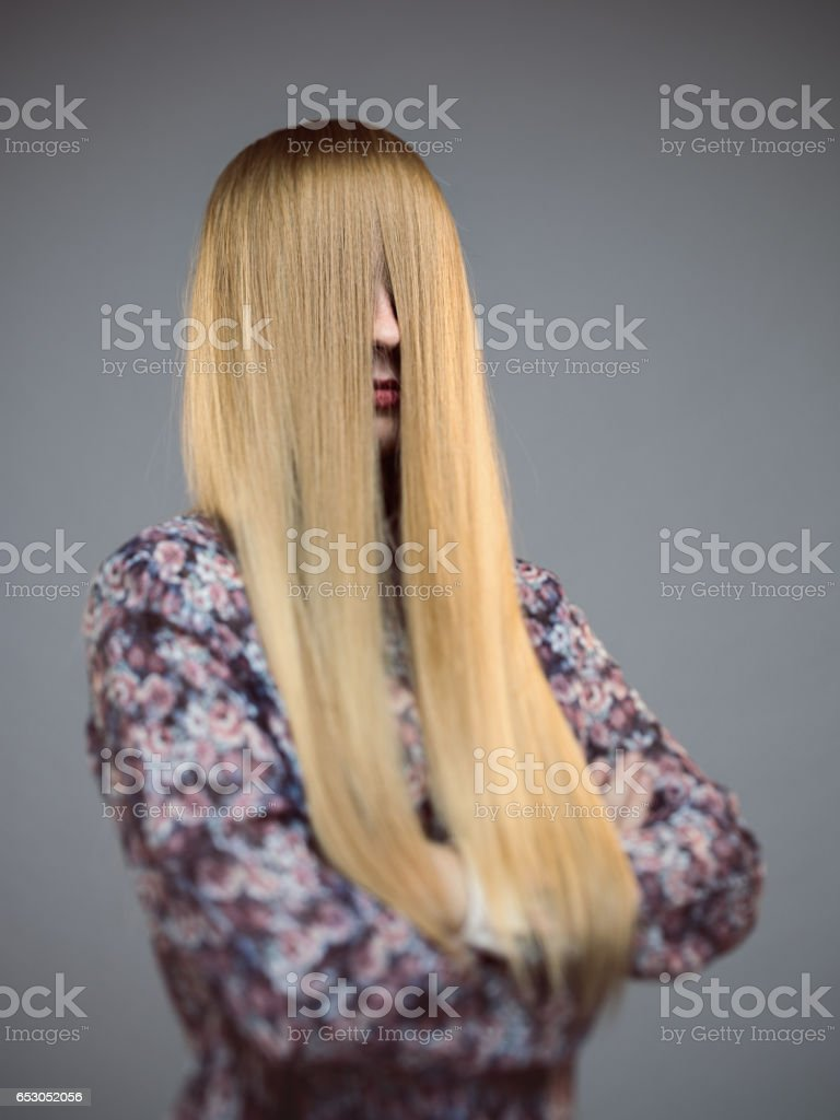 Young Woman With Face Covered By Long Blonde Hair Stock Photo More