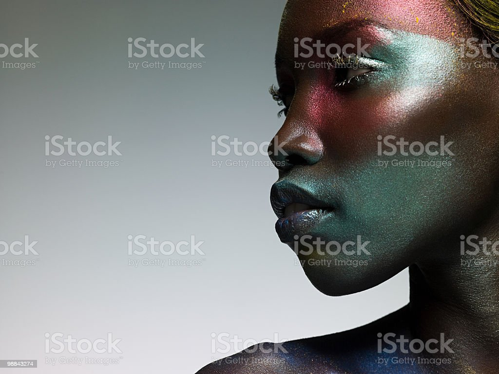 Young woman with face covered in metallic make up royalty-free stock photo