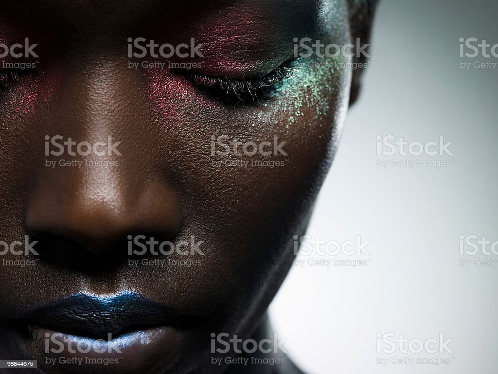 Young woman with face covered in metallic make up royalty free stockfoto