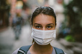 istock Young woman with face mask in the street 533567012