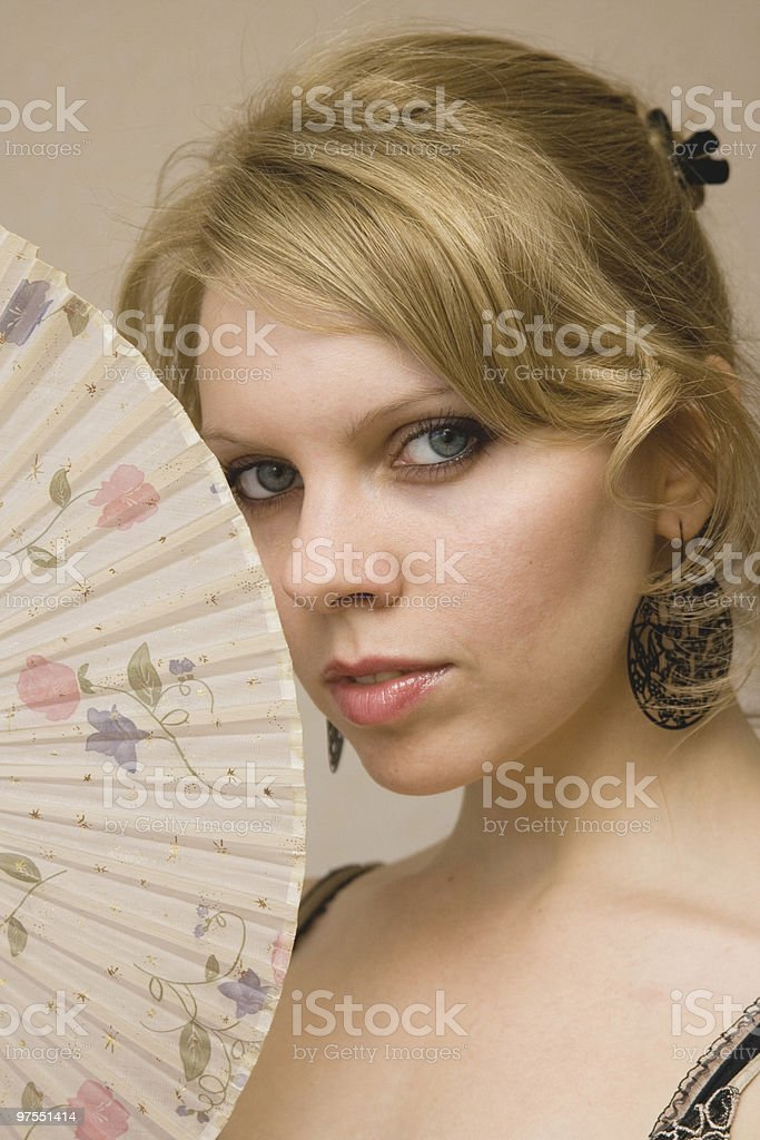 Young woman with fan royalty-free stock photo