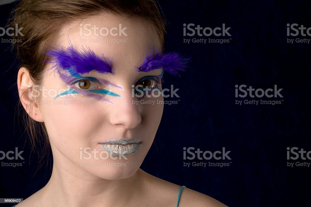 Young woman with feather eyebrows. royalty-free stock photo
