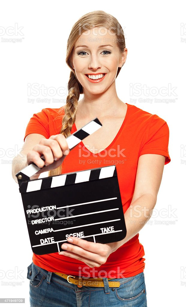 Young woman with film slate Portrait of young woman holding a film slate and smiling at the camera. Studio shot, white background. 18-19 Years Stock Photo