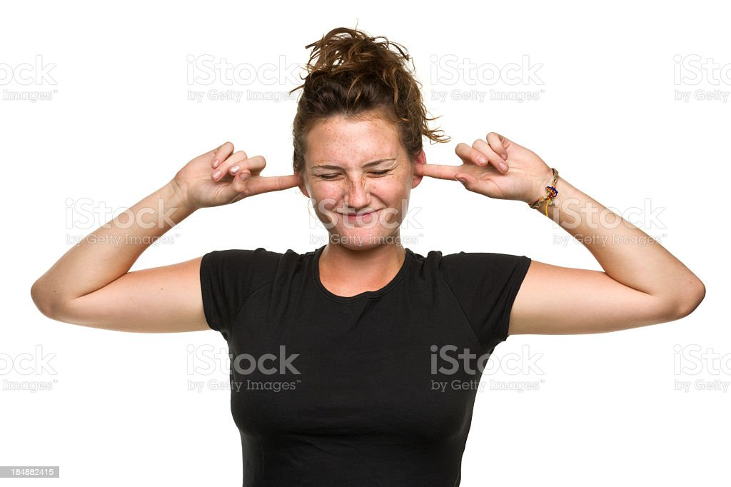 Young Woman With Fingers in Ears stock photo