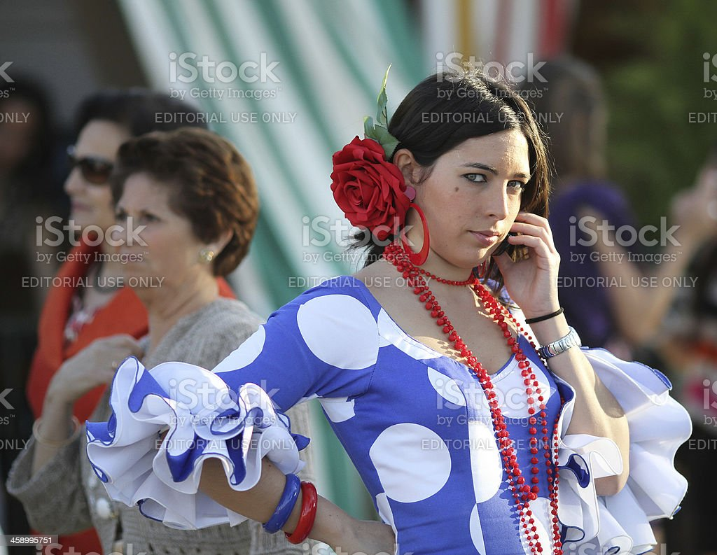 Young woman with flamenco dress during the April Fair royalty-free stock photo