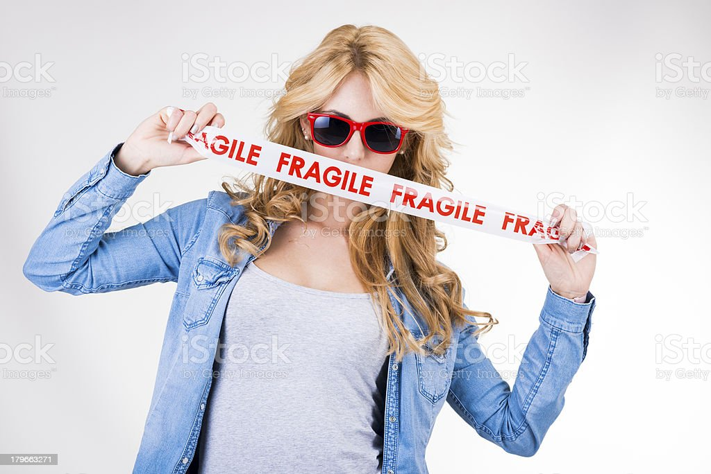 Young woman with Fragile adhesive tape royalty-free stock photo