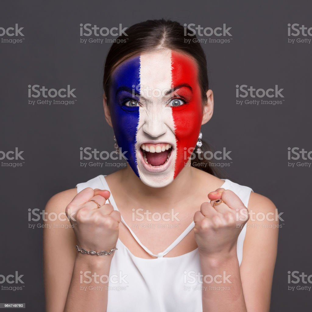 Young woman with France flag painted on her face royalty-free stock photo