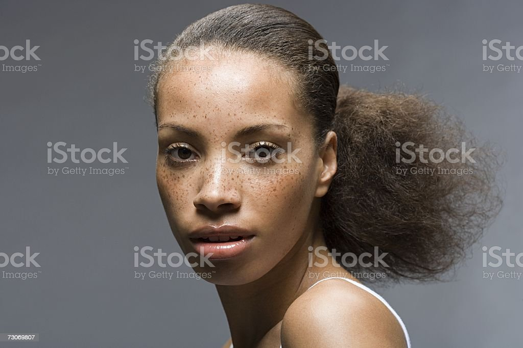 Young woman with frizzy ponytail stock photo