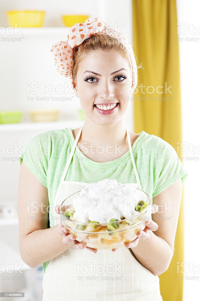 Young woman with fruit salad royalty-free stock photo