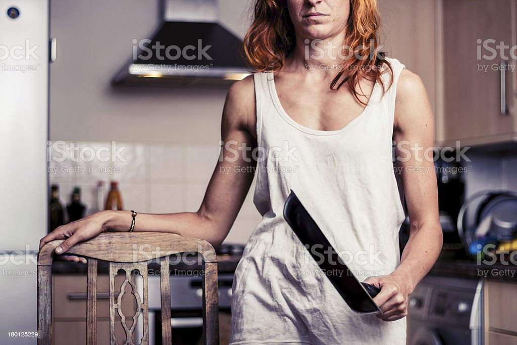 Young woman with frying pan in kitchen royalty-free stock photo