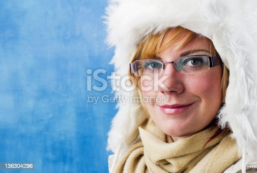 876629044istockphoto Young Woman with fur cap 136304296