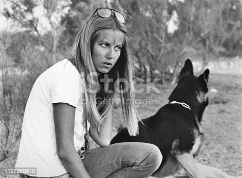 Young woman with german sheperd in 1970