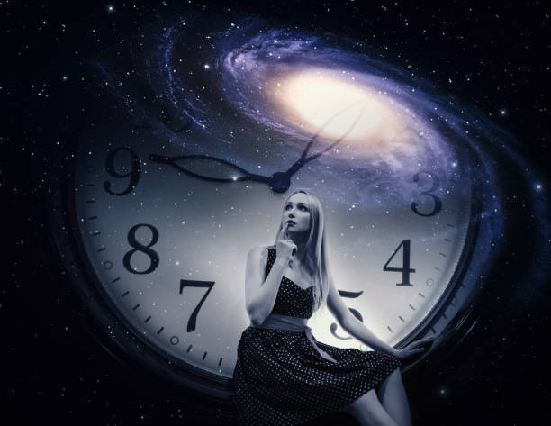 Young woman with giant clock and galaxy. stock photo