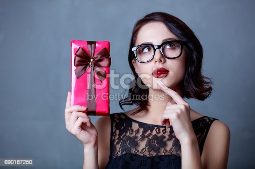 istock young woman with gift 690187250