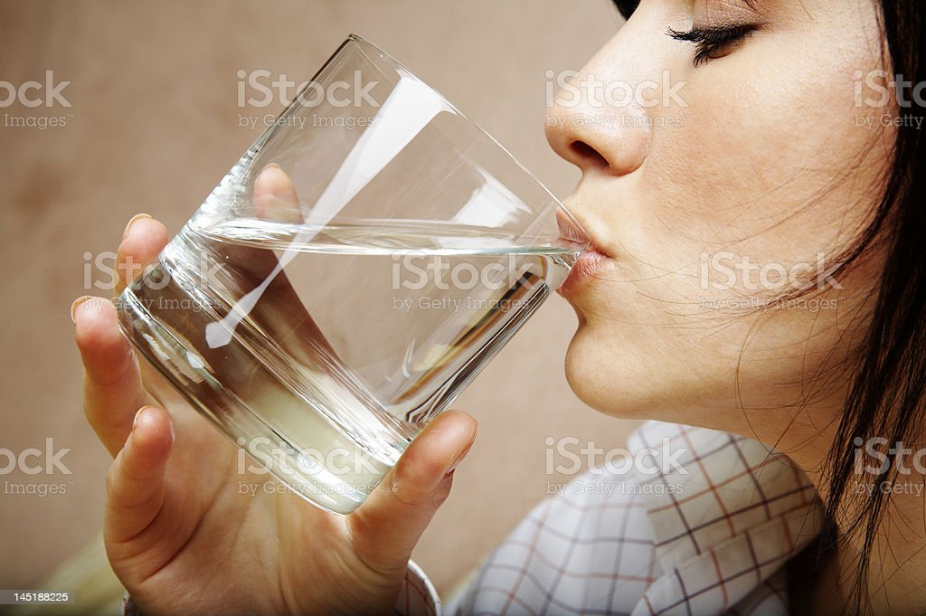 young woman with glass of mineral water royalty-free stock photo