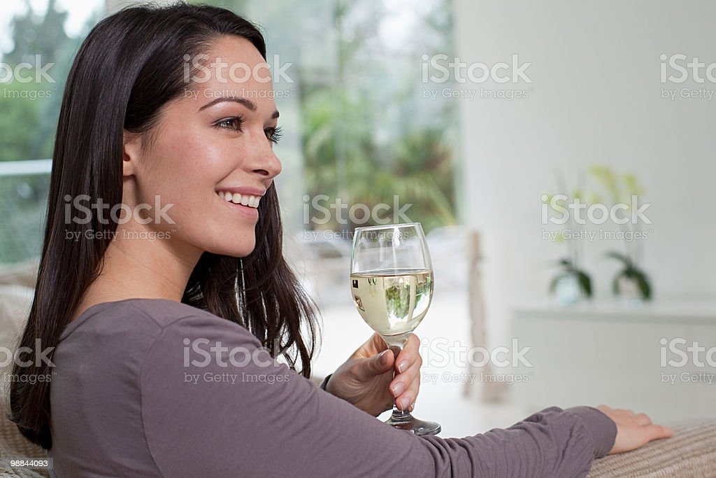 Young woman with glass of wine royalty free stockfoto