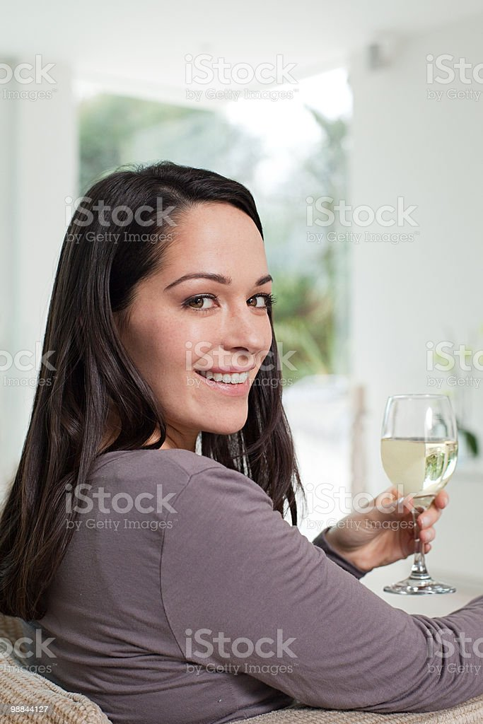 Young woman with glass of wine royalty-free stock photo